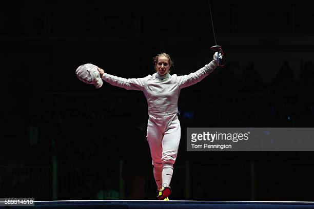Mariel Zagunis of the United States celebrates after the United States wins the Women's Sabre Team bronze medal match between United States and Italy...