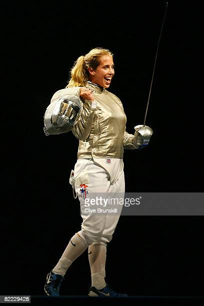 Mariel Zagunis of the United States celebrates defeating Becca Ward also of the United States in the fencing sabre semifinals event held at the...