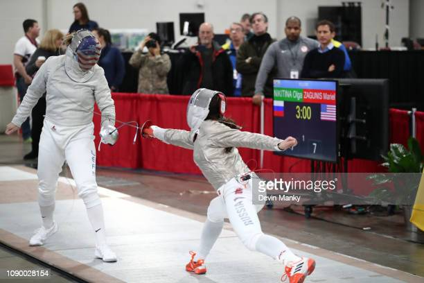 Mariel Zagunis of the USA fences Olga Nikitina of Russia in the final rounds at the Women's Sabre World Cup on January 26, 2019 at the Salt Palace...