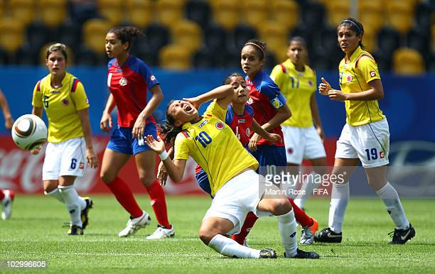 Mariela Campos of Costa Rica and Yorely Rincon of Colombia compete for the ball during the 2010 FIFA Women's World Cup Group C match between Costa...