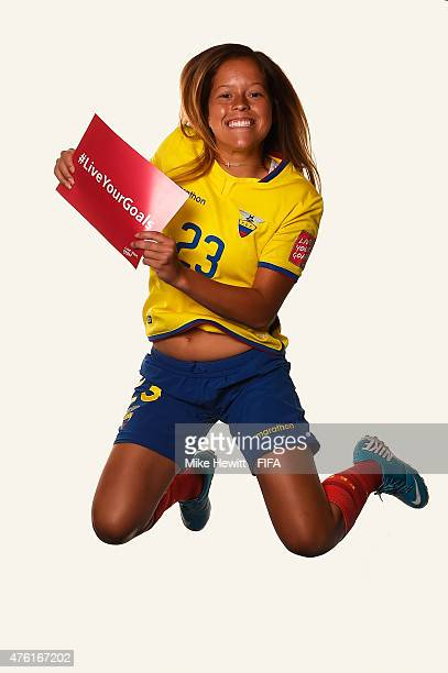 Mariela Jacome of Ecuador jumps with the #Live Your Goals sign during the official Ecuador portrait session ahead of the FIFA Women's World Cup 2015...