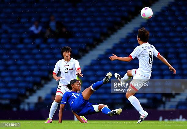 MarieLaure Delie of France battles with Jon Myong Hwa of DPR Korea during the Women's Football first round Group G match between France and DPR Korea...