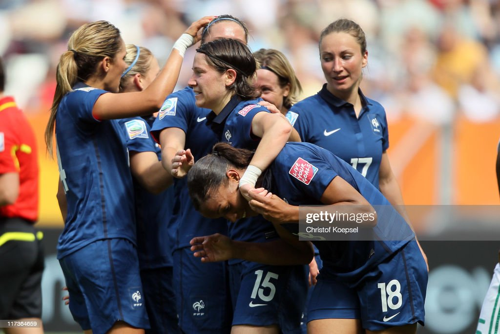 Marie-Laure Delie of France (R) celebrates the first goal with Elise Bussaglia of France (3rd L) during the FIFA Women's World Cup 2011 Group A match between Nigeria and France at Rhein-Neckar Arena on June 26, 2011 in Sinsheim, Germany.
