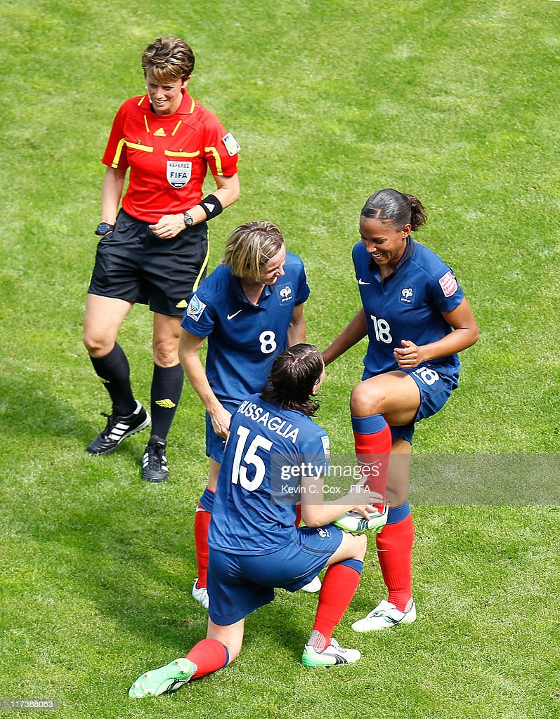 Marie-Laure Delie (R) of France celebrates with Elise Bussaglia and Sonia Bompastor after Delie's goal against Nigeria during the FIFA Women's World Cup 2011 Group A match between between Nigeria and France at Rhein-Neckar-Arena on June 26, 2011 in Sinsheim, Germany.