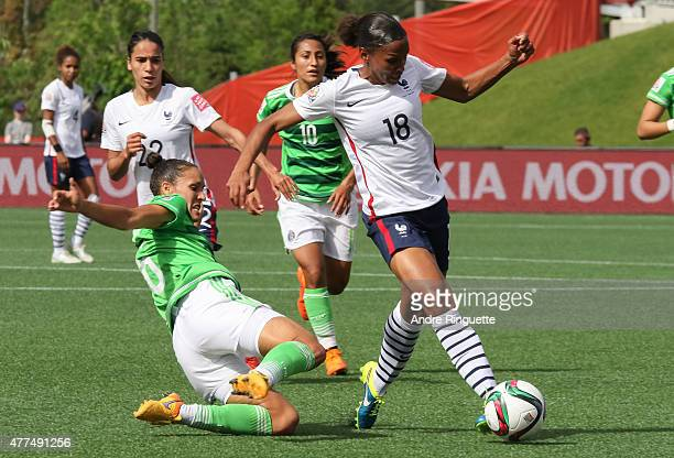 MarieLaure Delie of France dribbles the ball away from a tackle by Jennifer Ruiz of Mexico during the FIFA Women's World Cup Canada 2015 Group F...