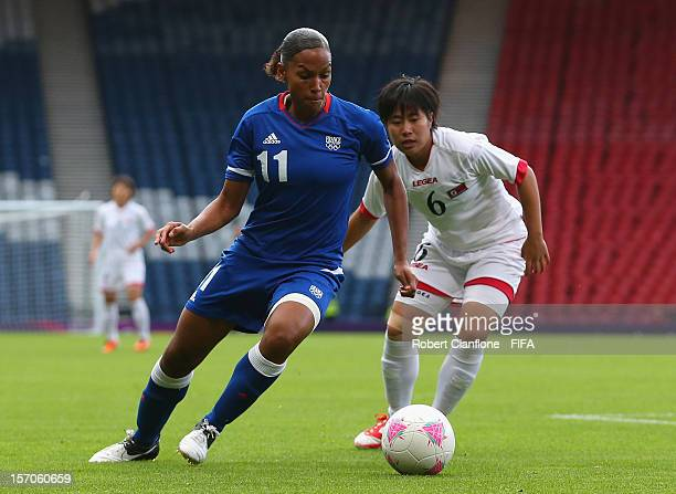 MarieLaure Delie of France is chased by Un Ju Choe of Korea DPR during the Women's Football first round Group G Match of the London 2012 Olympic...