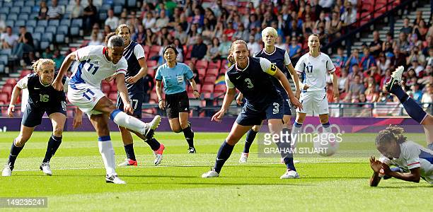 MarieLaure Delie of France scores their second goal against the US during a group G Women's football match of the 2012 Olympic Games at Hampden Park...