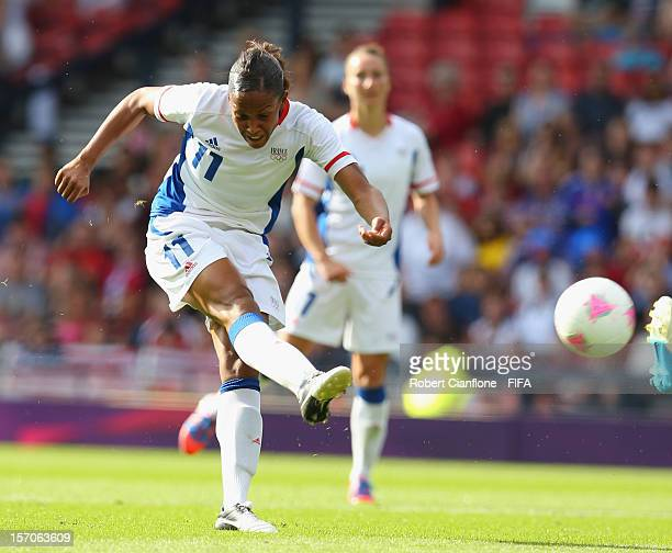 MarieLaure Delie of France shoots on goal during the Women's Football first round Group G Match of the London 2012 Olympic Games between United...