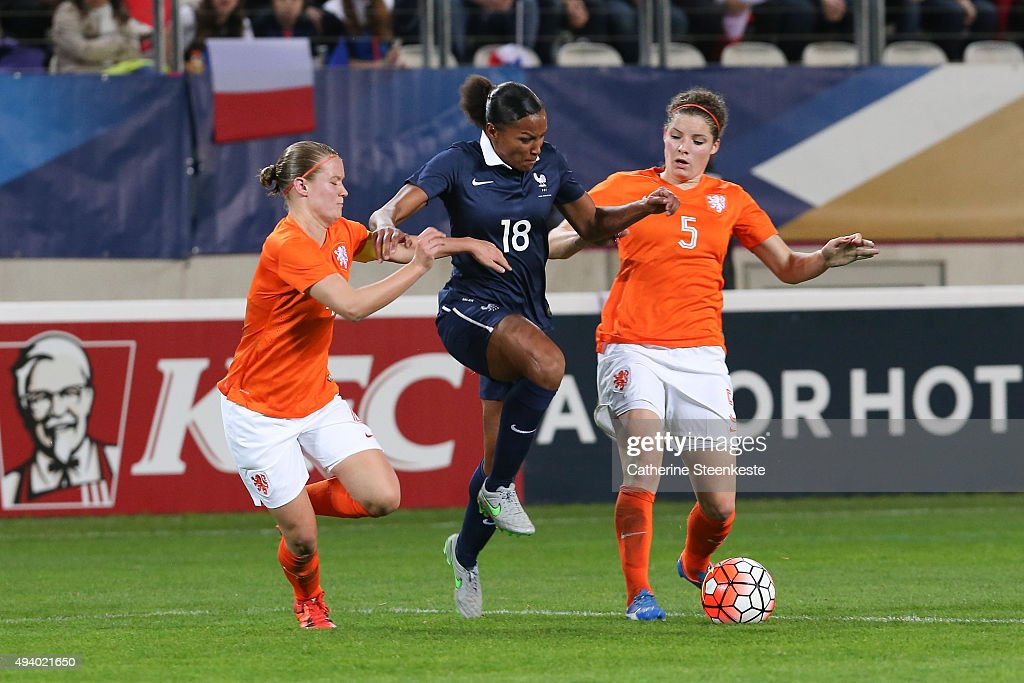 Marie-Laure Delie #18 of France tries to control the ball against Mandy van den Berg #4 and Dominique Janssen #5 of Netherlands during the international friendly game between France and Netherlands at Stade Jean Bouin on October 23, 2015 in Paris, France.
