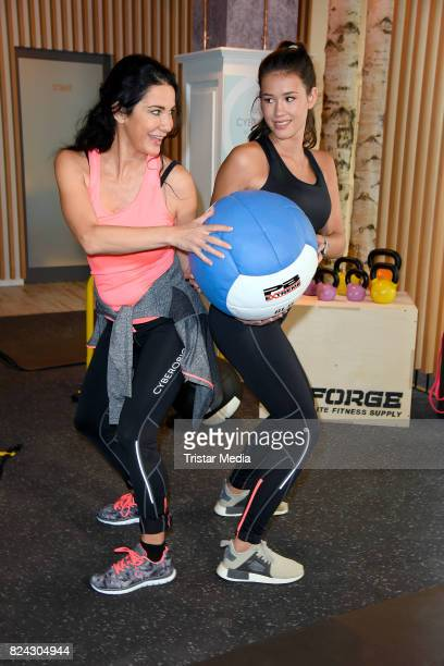 Mariella Ahrens and her daughter Isabella Ahrens train during the Cyberobics Women Club Opening on July 29 2017 in Berlin Germany