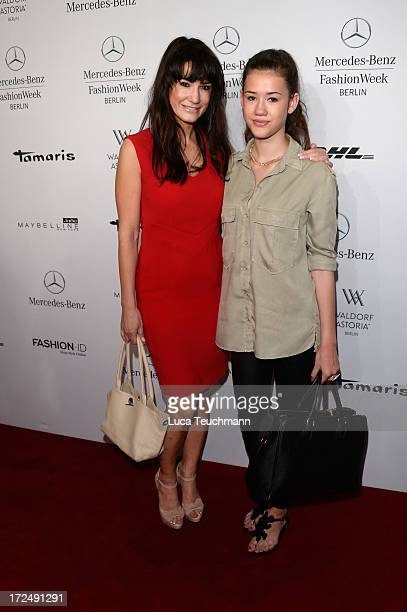 Mariella Ahrens and her daughter Isabella attend the Riani Show during MercedesBenz Fashion Week Spring/Summer 2014 at Brandenburg Gate on July 2...