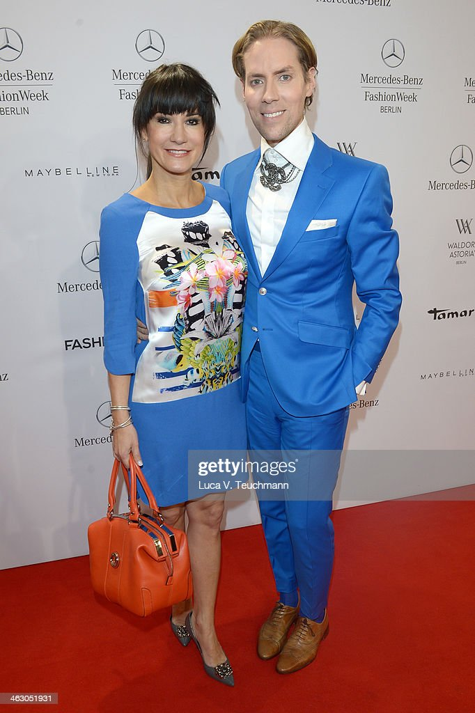 Mariella Ahrens and Jens Hilbert attend the Laurel show during Mercedes-Benz Fashion Week Autumn/Winter 2014/15 at Brandenburg Gate on January 16, 2014 in Berlin, Germany.