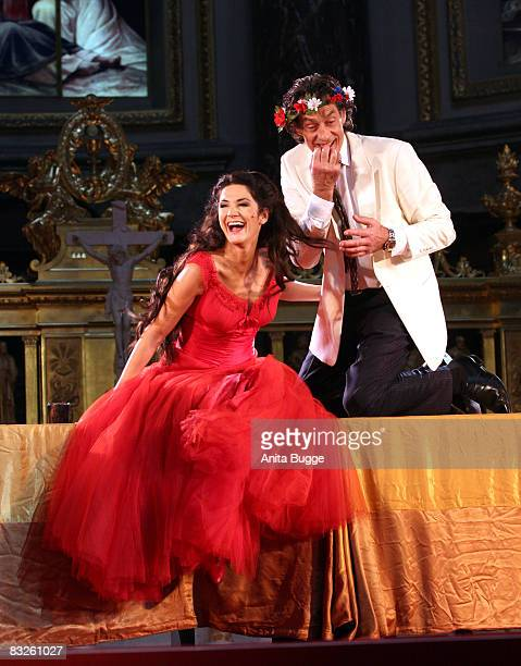 Mariella Ahrens Graefin von Faber-Castell as Buhlschaft and Wilfried Glatzeder as Jedermann perform during the dress rehearsal for the play...