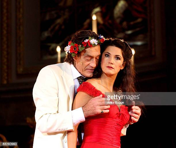 Mariella Ahrens Graefin von Faber-Castell as Buhlschaft and Winfried Glatzeder as Jedermann perform during the dress rehearsal for the play...