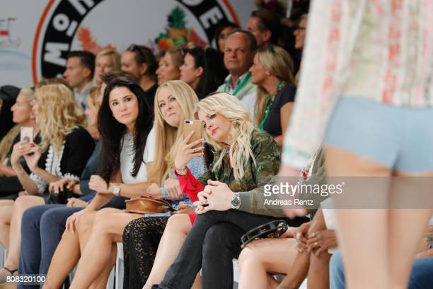 Mariella Ahrens Jenny Elvers and Jennifer Knaeble attend the runway at the Riani Fashion Show Spring/Summer 2018 at Umspannwerk Kreuzberg on July 4...