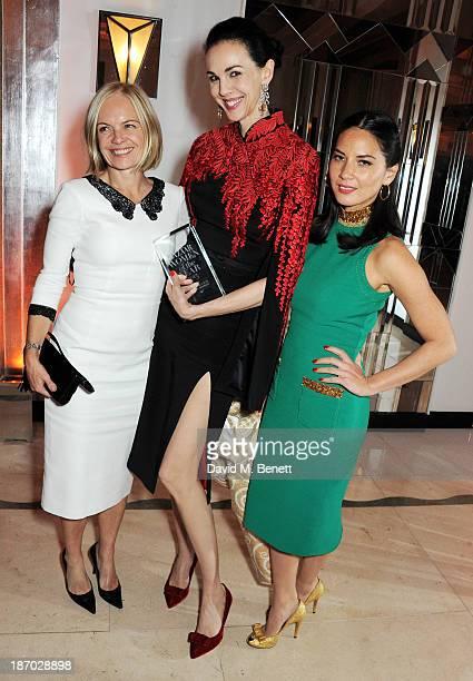 Mariella Frostrup, L'Wren Scott, winner of the Tastemaker of the Year award, and Olivia Munn attend the Harper's Bazaar Women of the Year awards at...