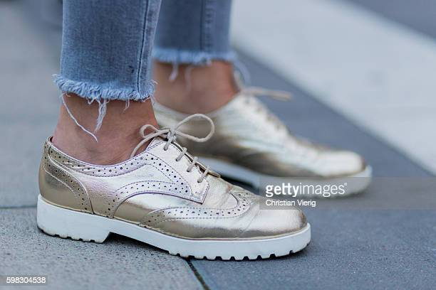 Marielle Kuenzer wearing golden shoes during the third day of the Stockholm Fashion Week Spring/Summer 2017 on August 31 2016 in Stockholm Sweden