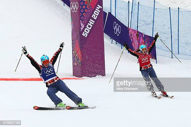Marielle Thompson of Canada celebrates winning the gold medal with silver medalist Kelsey Serwa of Canada in the Freestyle Skiing Womens' Ski Cross...