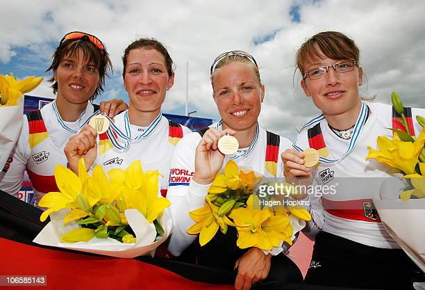 MarieLouise Draeger Anja Noski Daniela Reimer and Lena Mueller of Germany pose for a photo after winning gold in the Women's Lightweight Quadruple...