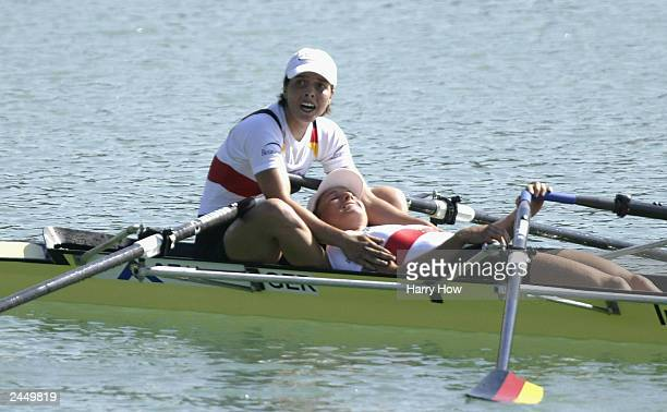 Marie-Louise Draeger celebrates a gold medal performance with Claudia Blasberg of Germany in the Lightweight Women Double Sculls Final during the...