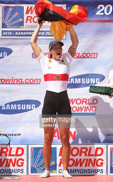 Marie-Louise Draeger of Germany celebrates gold on the podium after the Women's Lightweight Single Sculls during day eight of the World Rowing...