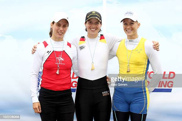 Marie-Louise Draeger of Germany poses with second placed Eliane Waser of Switzerland and third placed Sara Karlsson of Sweden after winning the...