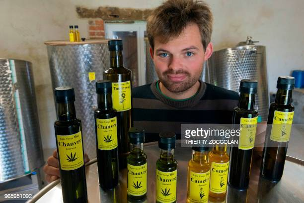 Marien Sablery an agricultor cultivating organic hemp on 25 hectares poses with products made with hemp in Evaux les Bains Creuse region on May 31...