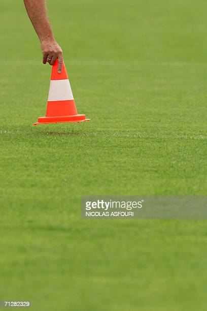Brazilian head coach of the Portuguese team Luiz Felipe Scolari puts a cone on the pitch during a team training session at The Klosterpforte Hotel in...