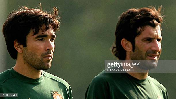 Portugal's football players Luis Figo and Deco stand on the pitch during a team training session at The Klosterpforte Hotel in Marienfeld, 28 June...