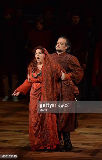 MarieNicole Lemieux and Riccardo Zanellato are seen during the 'Il Trovator' photo rehearsal on August 4 2014 in Salzburg Austria