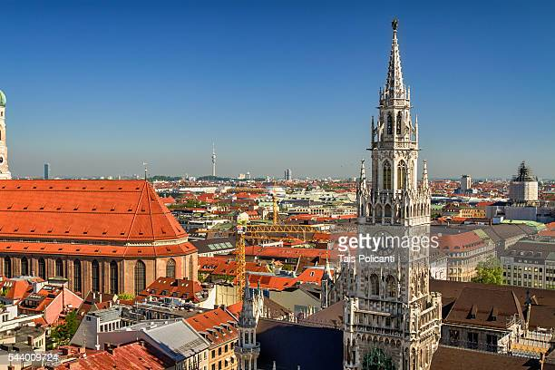 marienplatz city hall and munich cathedral in the central square of munich, bavaria, germany. - new town hall munich stock pictures, royalty-free photos & images