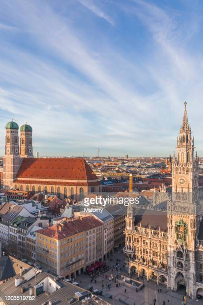 marienplatz in munich with old town hall and frauenkirche. panoramic skyline - international landmark stock pictures, royalty-free photos & images