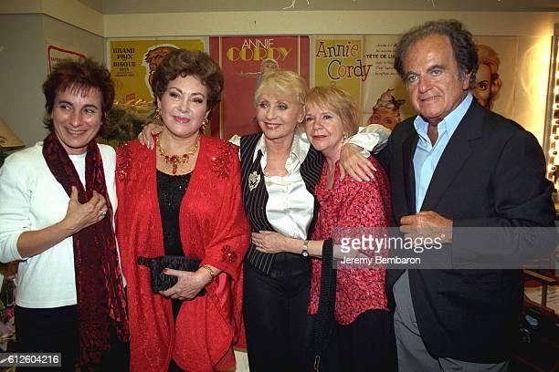 MariePaule Belle Rika Zarai and Guy Beart gathered around Annie Cordy