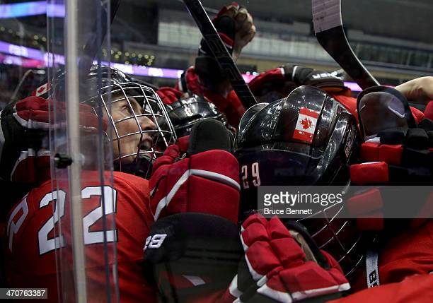 MariePhilip Poulin and Hayley Wickenheiser of Canada celebrate after defeating the United States 32 in overtime during the Ice Hockey Women's Gold...