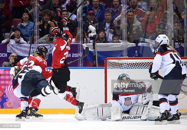 Marie-Philip Poulin of Canada celebrates after scoring a goal in the third period against Jessie Vetter of the United States during the Ice Hockey...