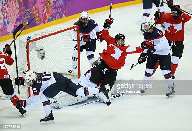 Marie-Philip Poulin of Canada celebrates after scoring against Jessie Vetter of the United States during the Ice Hockey Women's Gold Medal Game on...