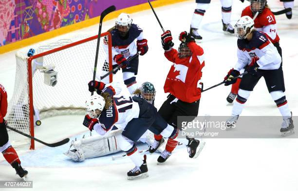 MariePhilip Poulin of Canada celebrates her goal against Jessie Vetter of the United States late in the third period during the Ice Hockey Women's...