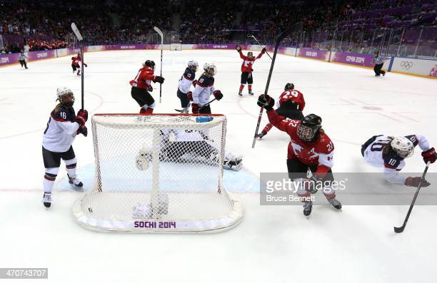 MariePhilip Poulin of Canada celebrates her goal with teammates against Jessie Vetter of the United States late in the third period during the Ice...