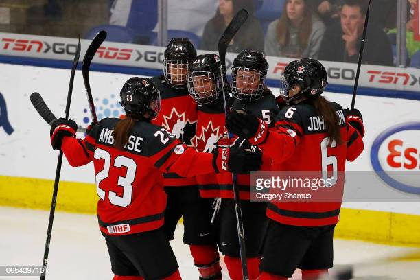 MariePhilip Poulin of Canada celebrates her second period goal with Erin Ambrose Natalie Spooner Lauriane Rougeau and Rebecca Johnston while playing...