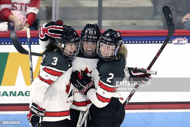 MariePhilip Poulin of Canada celebrates with Jocelyne Larocque and Meghan Agosta after scoring against the United States during the third period at...