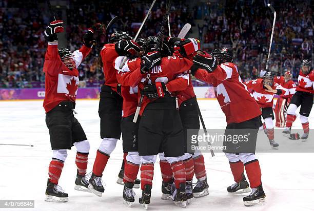Marie-Philip Poulin of Canada celebrates with teammates after scoring the game-winning goal against the United States in overtime during the Ice...
