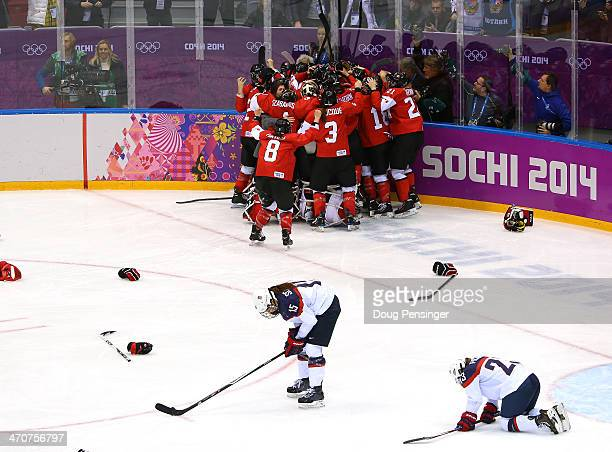 Marie-Philip Poulin of Canada celebrates with teammates after scoring the game-winning goal against the United States in overtime as Anne Schleper...