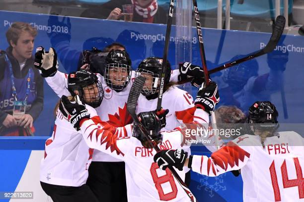 Marie-Philip Poulin of Canada celebrates with teammates after scoring a second period goal against the United States during the Women's Gold Medal...