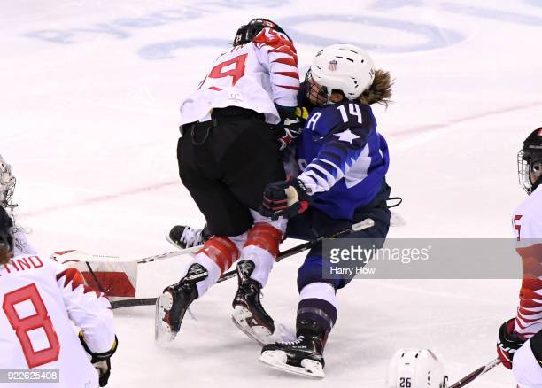 Marie-Philip Poulin of Canada collides with Brianna Decker of the United States in the third period during the Women's Gold Medal Game on day...