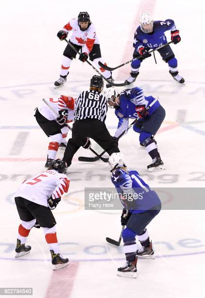 MariePhilip Poulin of Canada faces off against Kelly Pannek of the United States in the third period during the Women's Gold Medal Game on day...