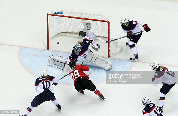 MariePhilip Poulin of Canada scores a thirdperiod goal against Jessie Vetter of the United States during the Ice Hockey Women's Gold Medal Game on...