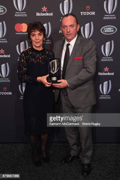 MariePierre Martin and JeanMarc Martin pose with the Vernon Pugh Award for Distinguished Service posthumously on behalf of their father Marcel Martin...