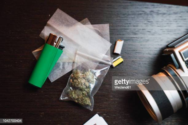 marihuana, cigarette lighter and analog camera on wood - hashish stock pictures, royalty-free photos & images