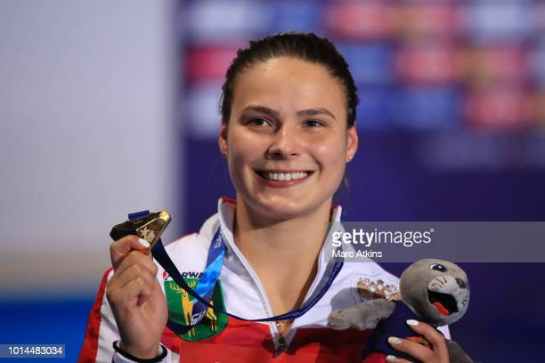 Mariia Poliakova of Russia celebrates with her medal after winning the Women's 1m Springboard Final on Day Nine of the European Championships Glasgow...