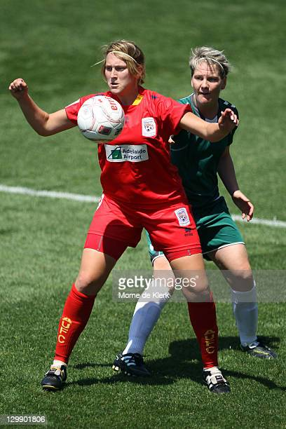 Marijana Rajcic of Adelaide gets the ball in front of Caitlin Cooper of Canberra during the round one WLeague match between Adelaide United and...